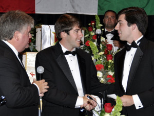 During the Founders Day Dinner and 125th Anniversary Celebration in 2012, Brother John Woodard (right) receives one of the Kappa Sigma Scholarships from Gamma Home Corporation President, Brother Chip Weimar (left) and the 2012-2013 President of the Alumni Association, Brother Adam Vegas (center) presented during the Founders Day Dinner as part of the 125th Anniversary celebration weekend.